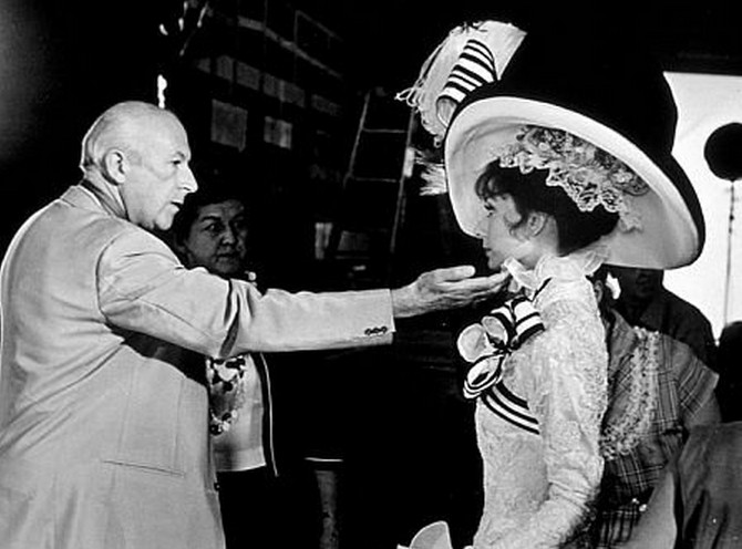 Production-Designer-Cecil-Beaton-checks-Audrey-Hepburns-costume-on-the-set-of-My-Fair-Lady-1964