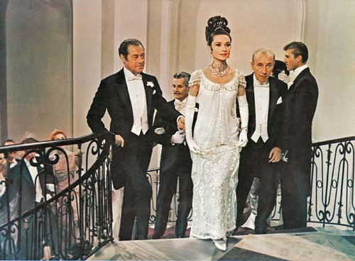 Movie Still, Eliza entertain the ball flanked by dashing looking Rex Harrison and Wilfrid Hyde-White
