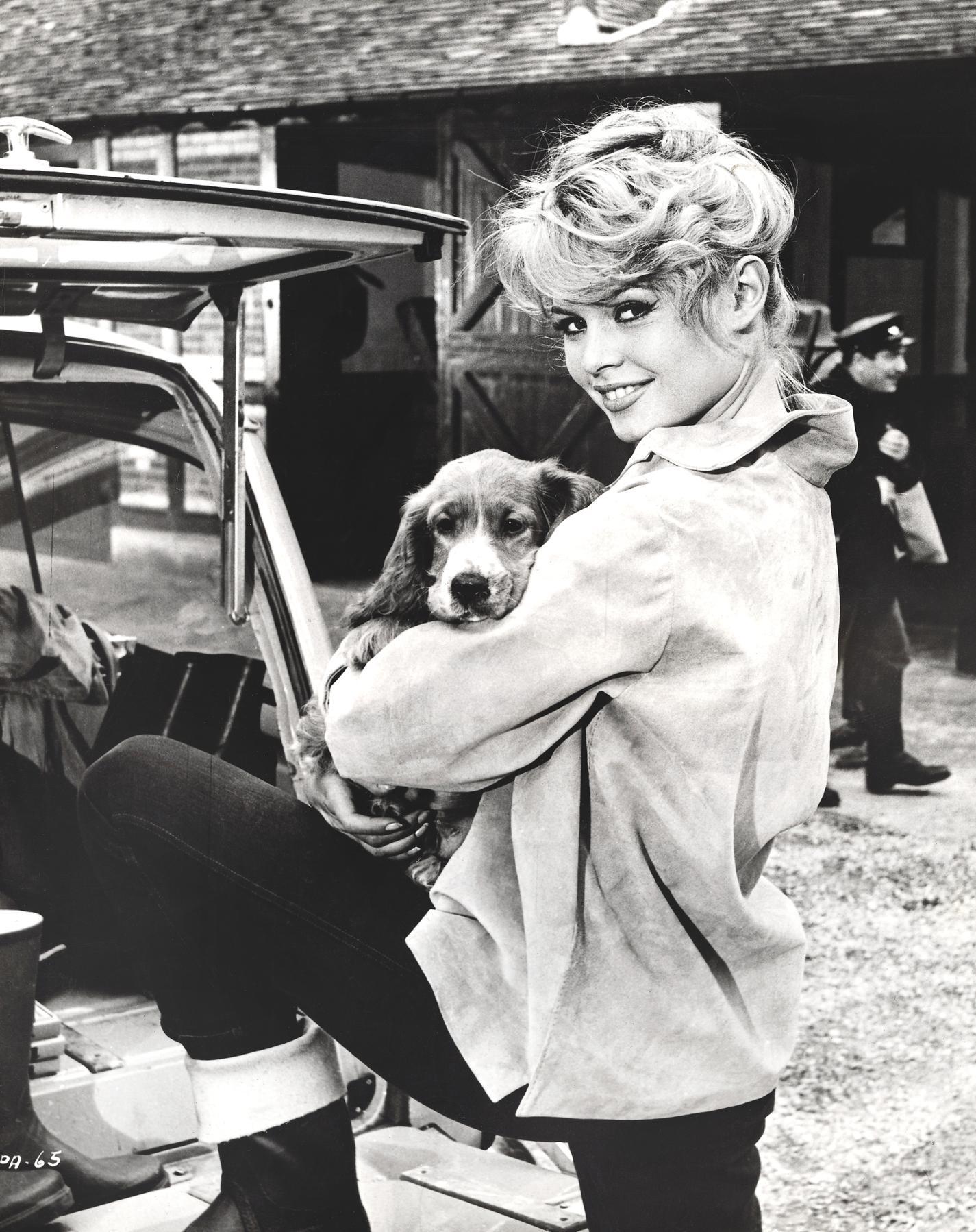 Brigitte Bardot Holding Dog